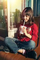 girl drinking through a straw
