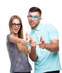 Happy couple smiling holding thumb up gesture, beautiful young m
