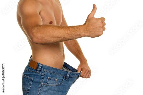 canvas print picture Mann nach erfolgreicher Diät