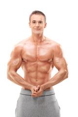 Young male bodybuilder flexing his muscles