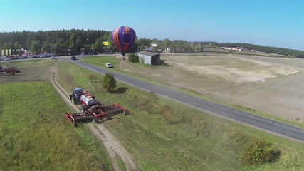 Modern new tractor  and balloon . Aerial