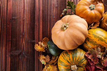 Autumn pumpkins on wooden planks