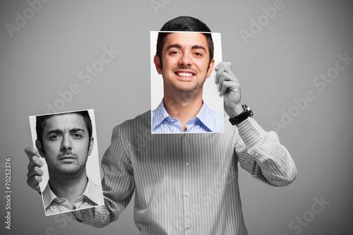 Man changing his mood - 70252376