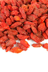 dried goji berries isolated on white