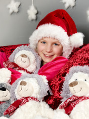 Girl on Christmas Eve with many stuffed animals
