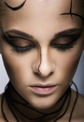 Beautiful cyber girl with linear black makeup