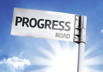 Progress written on the road sign