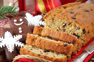 Sliced Christmas chocolate cake with festive cookies