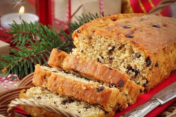 Sliced chocolate Christmas cake in a festive setting
