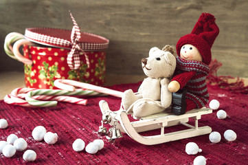 Christmas miniature toys on sledges and gift box with candies