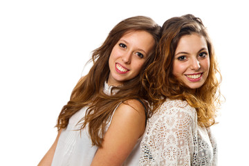 Two girl friends isolated over a white background