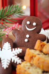 Chocolate cookie gingerbread man with Christmas sweets