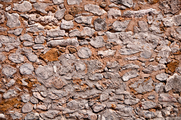 Old natural stone wall background texture