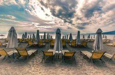 lounge sun bed and umbrella on tropical beach sunrise morning