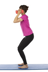 Active senior woman lifting dumbbells during pilates