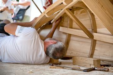 Boat builder at Danube festival in Ulm, Germany