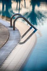 Aluminium steps at the edge of a swimming pool