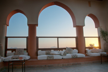 Seating Area with Arched Windows at Sunset