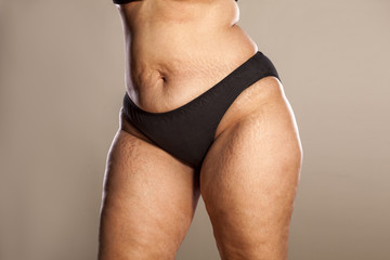 hips of a very thick woman in black panties