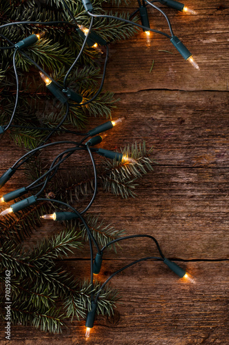 canvas print picture Christmas. Fir with garland on the table
