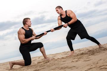 Bodybuilders on the beach