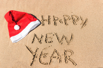 """written in the sand, """"happy new year"""""""