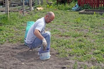 a man sitting down gardening