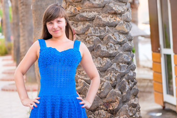 happy beautiful girl 20 years old in a blue sundress