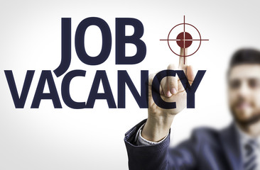 Business man pointing the text: Job Vacancy