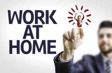 Business man pointing the text: Work At Home