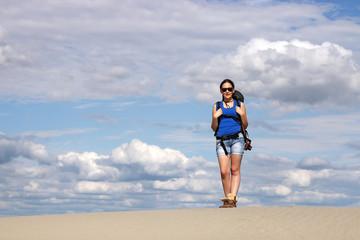 beautiful girl hiking in desert