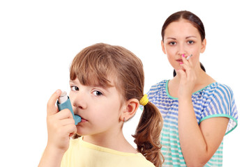 little girl with inhaler and girl smoking cigarette