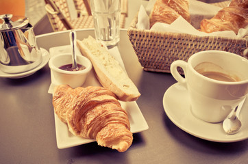 coffee and croissants on table