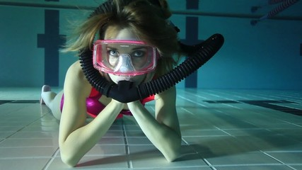 Female scuba diver relaxing underwater
