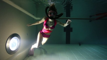 Female scuba diver out of air