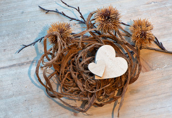 Two Wooden Hearts in Rope Nest