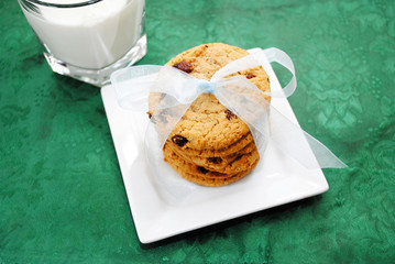 Cjocolate Chips Cookies with a Bow and Milk