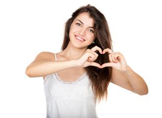 Beautiful girl shows a heart symbol