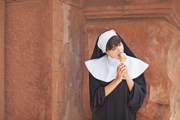 Nun secretly eating ice cream