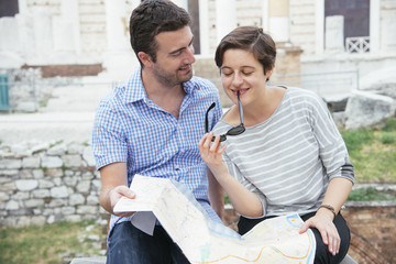 tourists couple map