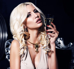 portrait of sexy woman with glass of champagne