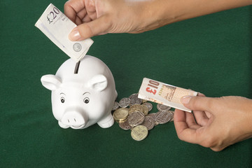Piggy Bank with banknotes and coins