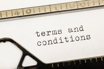 Terms and conditions written on old typewriter.