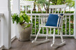 white wooden rocking chair on front porch at home - 70267385