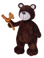 Brown teddy bear with wooden rattle