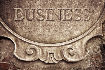 Business written on stucco wall - concept image