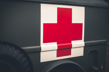 Close up of a red cross on a vintage army ambulance