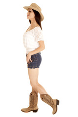 Brunette cowgirl stand facing side full body