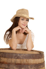 cowgirl tan hat behind barrel smile