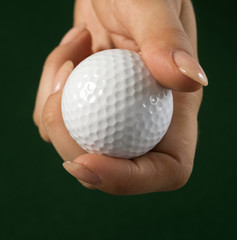 Golf ball in a woman's hand